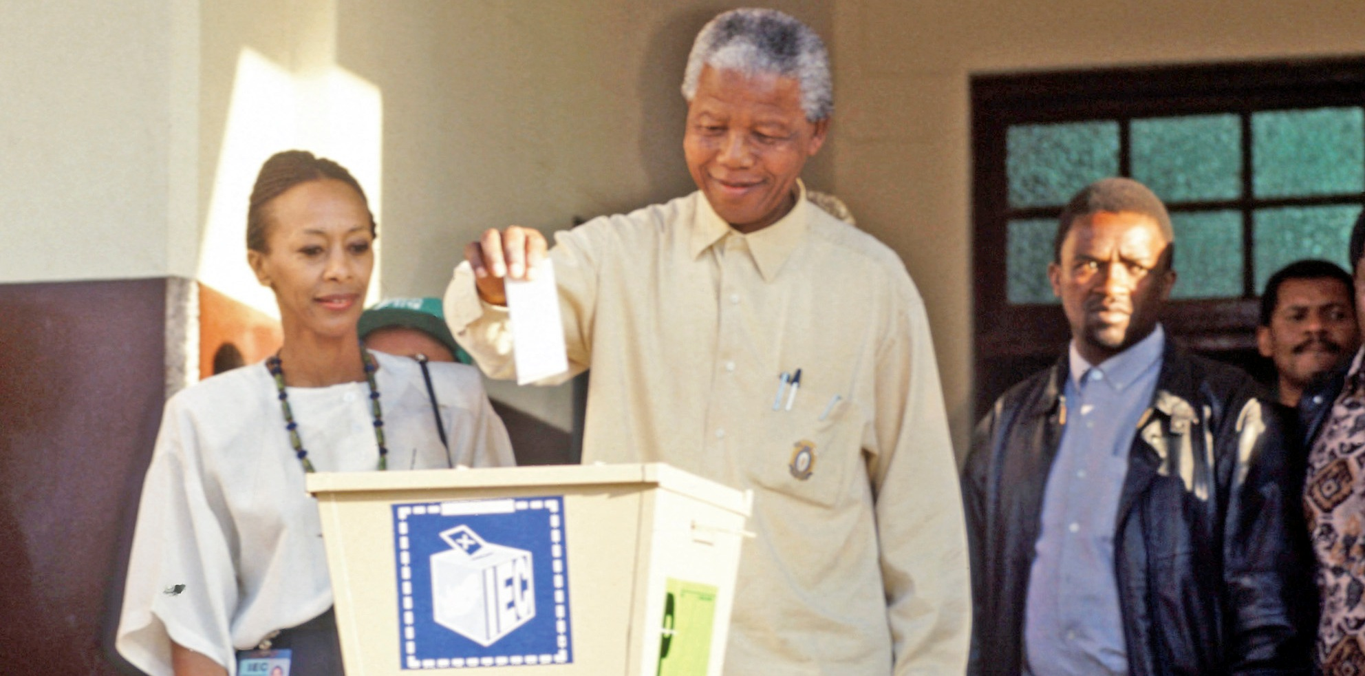 Nelson Mandela drops vote into ballot box