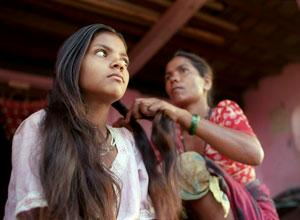 A girl from India getting her hair done