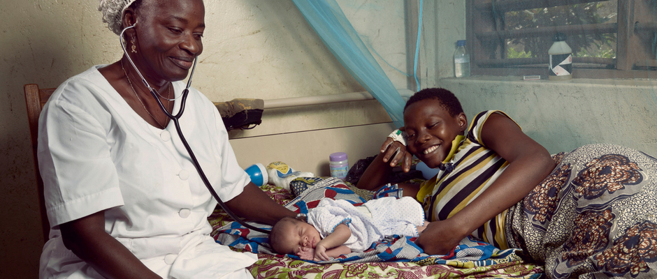 A nurse examines a mother and her newborn in Benin.