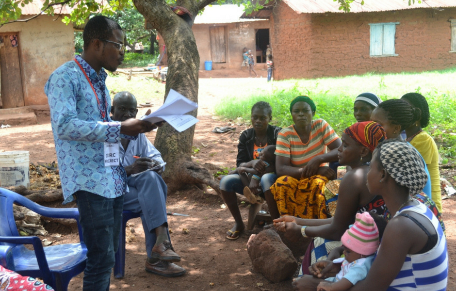 Person talking to a group in Edo State, Nigeria.