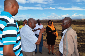 The Kiwanjani Location Chief takes researchers on a site visit to Isiolo Airport,Kenya