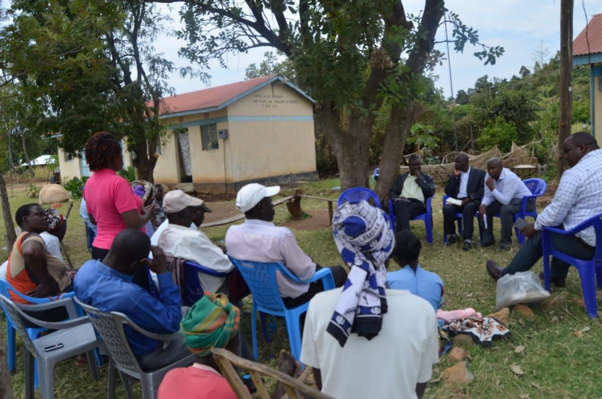A participant contributes to a focus group discussion with residents of Obare in Siaya County, Kenya