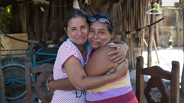 Francisca del Rosario Nataren Zavala (left),39,and Silvia Infante Alvarez,45,both local beneficiaries of the Prospera project,naturally hug while posing for a photograph. Democratica Chiapaneca,Tonala,Chiapas,Mexico.