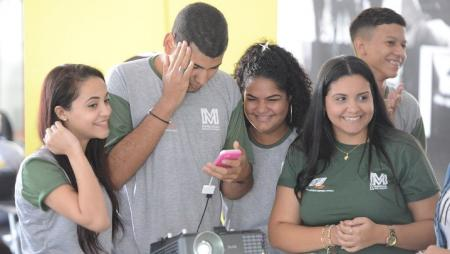 Students in Brazil participating in financial training.