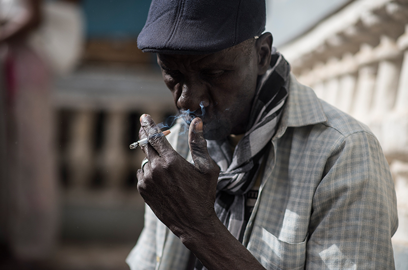 A Senegalese man smoking