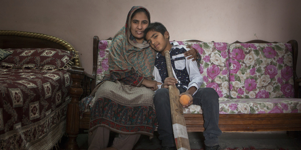 Husnain Azam, 14, lives with his mother and the rest of their family in a one-room apartment in Islamabad.